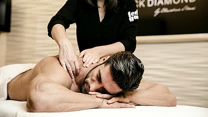 man enjoying a massage during a spa vacation at STOCK Resort