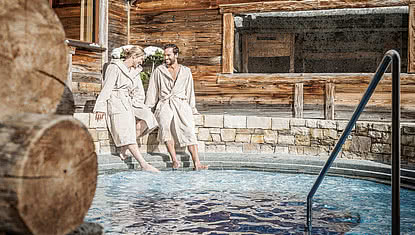 couple at the whirlpool in the wellness hotel STOCK in the Zillertal